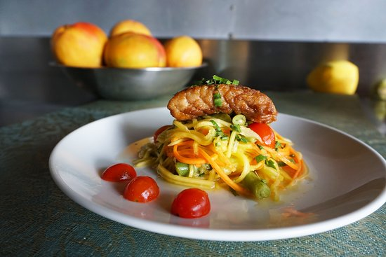 A freshly caught grouper fillet on top of our Thai Green Mango Salad. A fresh and satisfying option!