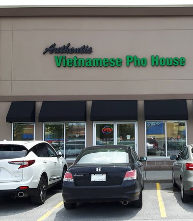 Front view of the Authentic Vietnamese Pho House with plenty of parking infront of mall.