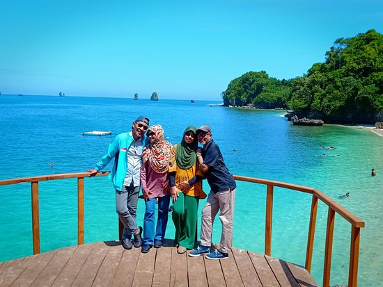 Our customer taking picture at Three Color Beach in South Malang.