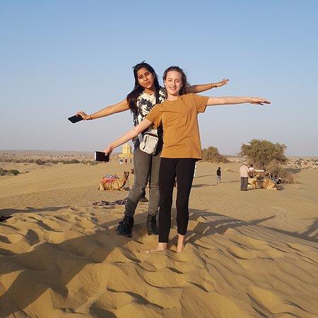 Girls, enjoying the sunset on the dunes