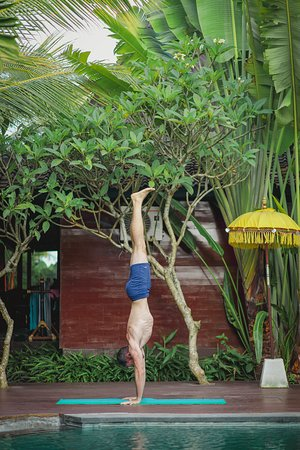 Bisma Cottages: Yoga Man on Pool Deck