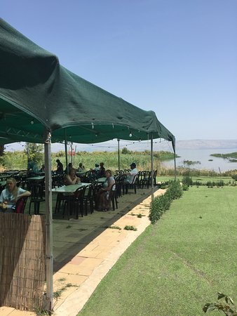 4.  Ali's Restaurant - exterior dininr area with Sea of Galilee in the background