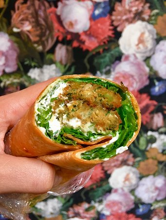 The Wooden Spoon: Vegetarian wrap packed with lettuce, cream cheese, pesto, falafel and hummus