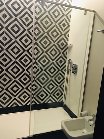 handheld shower and ceiling shower provided...