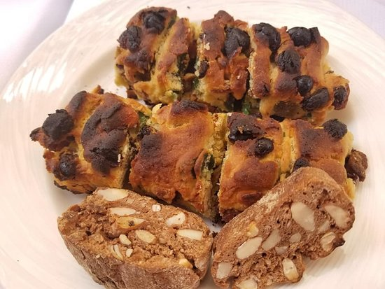 Jews Travel Rome: Pizza Ebraico and biscotti with almonds.  The Pizza Ebraico is a sweet bread sold at a centuries old bakery, by the same family.  The recipe is a secret.