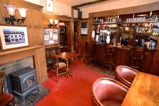 Bar area with wide selection of gins, whiskies, spirits and real English ales