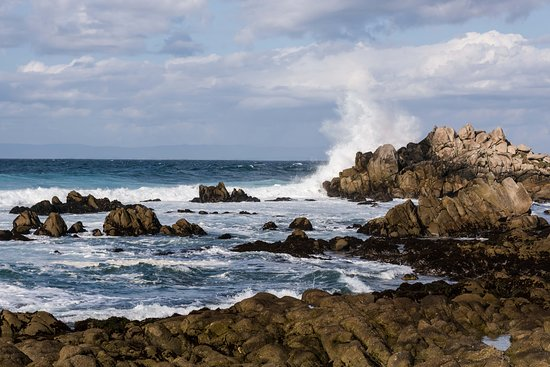 Waves Crashing Into the Rocky Shore of the Bay