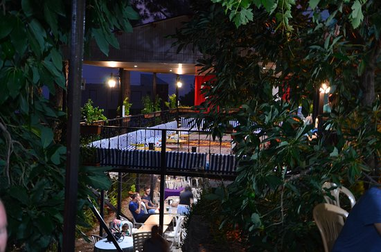 Our terrace in the night. You can have your meal and drinks either on top or downstairs
