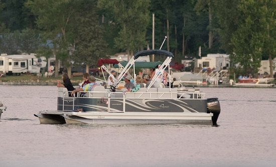 Churubusco, IN: cruising on the pontoon in front on campground, on Blue Lake