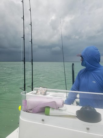 Captain Ed surveying the storm that was approaching.  We ended up avoiding most of it due to his navigation skills and he still took us to a few spots to fish!