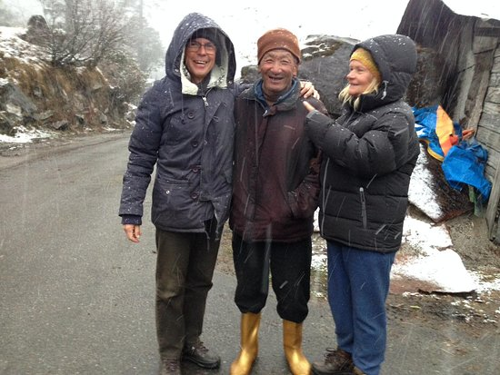 Ease Tours & Treks: Guest from Hungary interacting with local man.