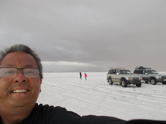 "At a ""wet salar"" area on the Salt Flat with also some other groups (the sixth stop)"