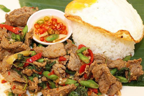 Phad Gra Prao Steak - Stir fried Top Sirloin steak, basil, chili, garlic and chopped green beans.*picture shows extra side of fried egg and rice.