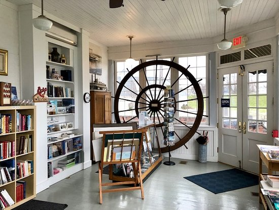 All tours begin on the back porch, an inviting space that also doubles as our gift shop.  Yes, that pilotwheel is the real thing!