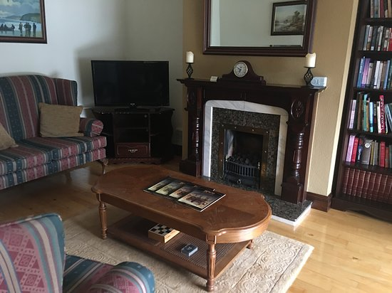Ashville House: Sitting room with a warm fireplace.