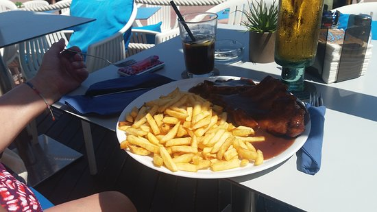 The rack of ribs with fries.