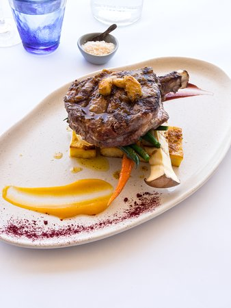 Char grilled rib eye (350gms), smoked garlic butter, duck fat potatoes, red wine gel