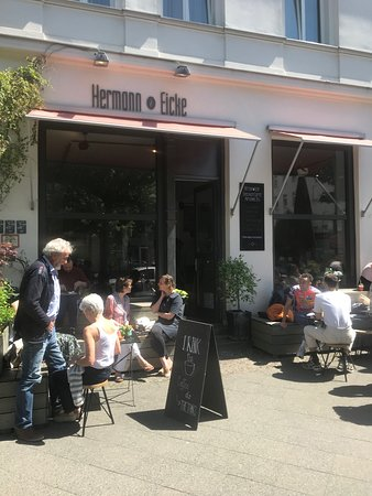 Soaking up the sun in front of the cafe - Picture of Hermann Eicke