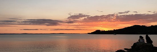 Waiheke Island, New Zealand: A typical sunset viewed from one of Waiheke's numerous beaches... enjoy the atmosphere over a glass of champagne from our chilled picnic hamper at the end of your full- or half-day tour of the Island.