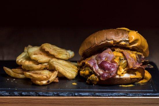 Cielo Mar All Day Bar: Bacon mushroom melt burger with cheddar sauce on the top. Burger 50% pork- 50% veal , bacon, mushrooms and cheddar sauce.