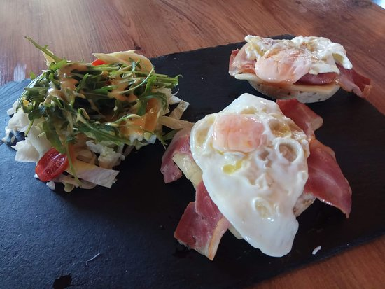Cielo Mar All Day Bar: Sunny wide up eggs with cheese qnd bacon. Server with colorful salad with aromatic dressing.  On our breakfast and Brunch menu.
