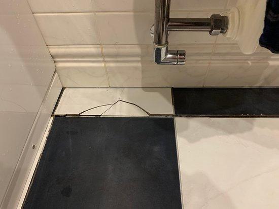 Cracked tiles in bathroom.