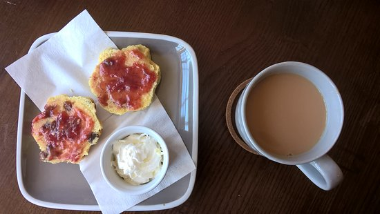 The Duke Of Wellington: Warm home-made scone with jam and butter, whipped cream and a mug of tea.