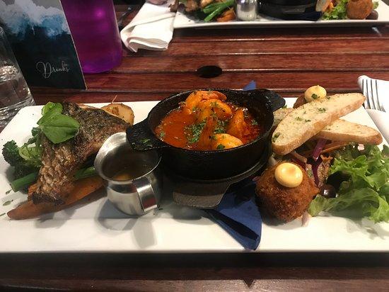 Seafood tasting plate - arancini crab balls, sizzling prawn hot pot and local fish (flathead) - really yummy!