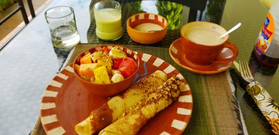 Yummy sweet breakfast with pancakes and delicious fruit salad