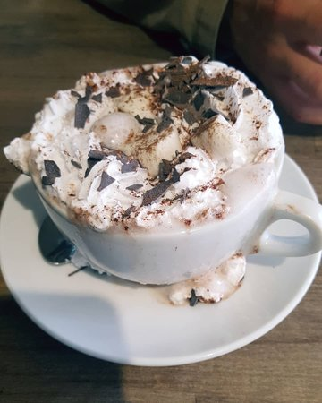Vegan hot chocolate with added soy whip, marshmallows and chocolate flakes