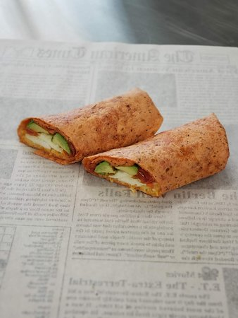 Six Shooter Breakfast Wrap: Egg, Avocado, Roasted Tomato, Shredded Monterey Jack Cheese Toasted in a Tomato Basil Wrap