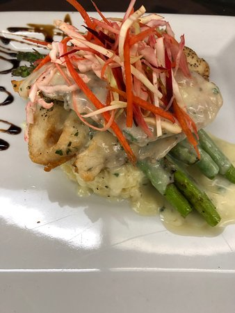 Pan seared fresh Sea Bass with grilled asparagus and lemon parmesan risotto