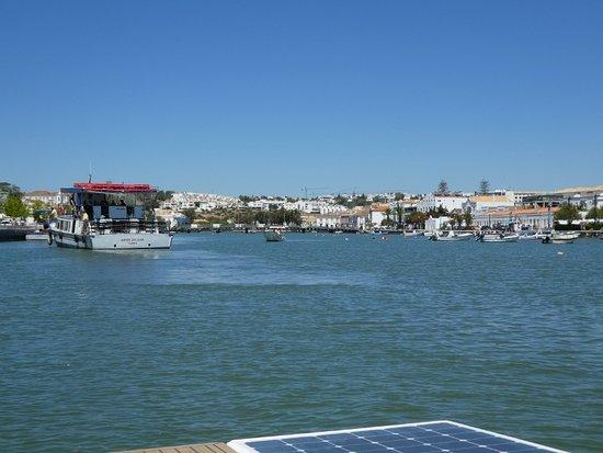 Solar Moves: Tavira city from Gilao River