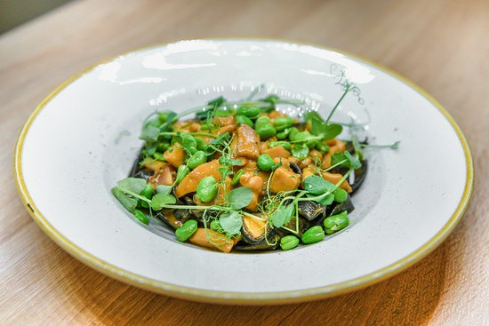Black Tagliatelle With Cuttlefish And Broad Beans Cuttlefish sauce, broad bean, grana Padano cheese, dark tagliatelle