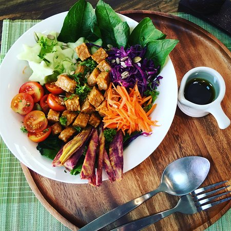 Lunch for staff mixed salad with tempeh and dressing