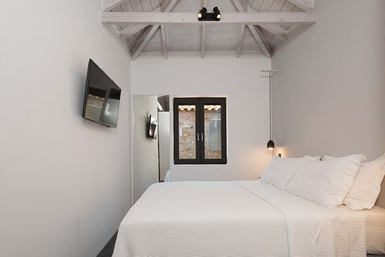 All suites feature double bed with Cocomat mattress & bedding made of natural materials