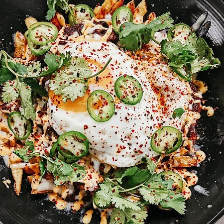 Oxtail Poutine fries | braised oxtail | siracha mayo | fried egg | jalapeno | green onion