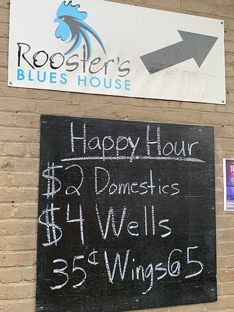 Signage for Rooster's Blues House Happy Hour specials.