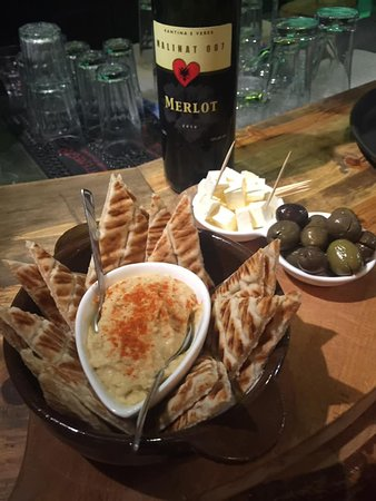 Tree House Lounge: Our signature plate: Hummus & Pita, local olives and white cheese. Great small dish to accompany with wine