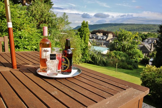 Drinks al fresco, enjoying the view over Pitlochry from our garden patio at Tigh NA Cloich Hotel