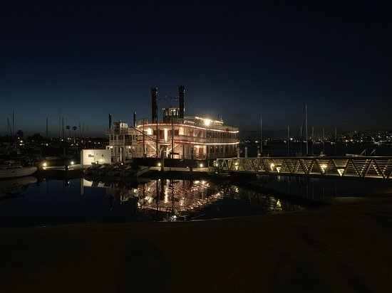 Paddle boat at night at the dock. Nightly bay tours are included with your stay