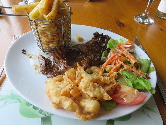 Sirloin Steak with chips, onion rings & salad garnish