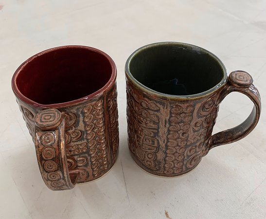 Weaverville, NC: Copper colored mugs with spiral designs are representative of the ever changing selection of mug designs.