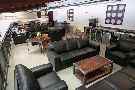 Broken Earth Winery: Our member's mezzanine complete with couches for enjoying your wine experience