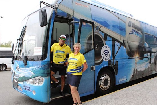 Cannonvale, Australien: Whitsunday Transit staff members, our airport ambassador Shana and bus driver Anthony, waiting to welcome our guests at Whitsunday Coast Airport (PPP)