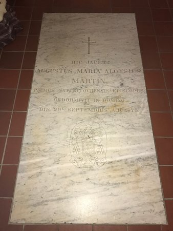 One of 2 graves INSIDE the church