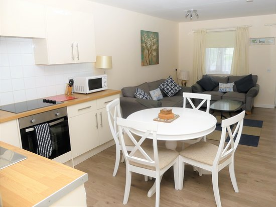 Golden Acre Jurassic Coastal Lodges: Summer Lodge 21 is wheelchair accessible with a large wheel-in wet room. Sleeps up to 4 adults. Surrounded by open park gardens and a short stroll to Eype Beach, lovely for swimming in the sea and pet friendly all year round.