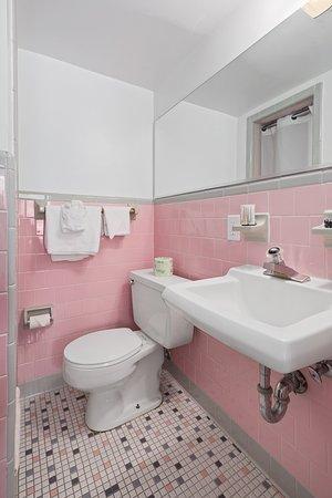 Americana Hotel: Single room bathroom with shower only. 3rd floor. Purple. Ben Franklin.
