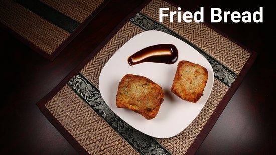 Fried bread topped w/ mixed ground pork and shrimp spread. Served w/ sweet and spicy sour sauce