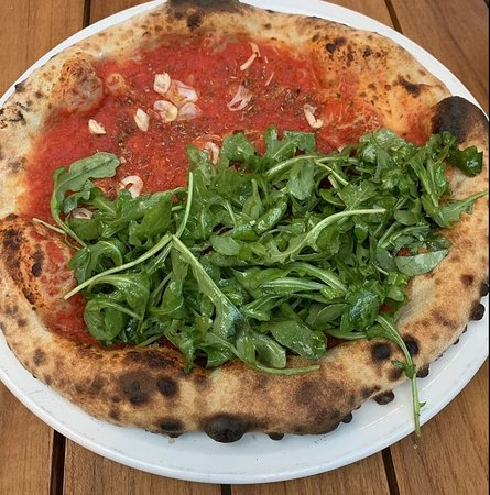Margharita pizza half side with arugula one of the best pizzas I've had